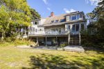 Expansive back deck with outdoor seating and screened porch