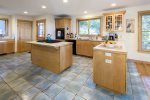 Screened porch and back deck overlook the marsh