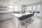 Aerial view of cottage and beach in August this property has the white roof