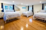 Oversized second upstairs bedroom with double bed and two twins