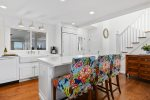 Gorgeous eat-in kitchen is fully stocked with all the amenities