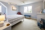 Upper lever bedroom with queen bed, crib and water views