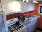 Galley kitchen features a gas stove