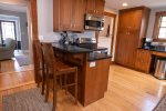 Fully equipped kitchen features an icemaker as well