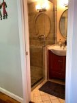 The second bathroom is off the mudroom entry and also features a shower
