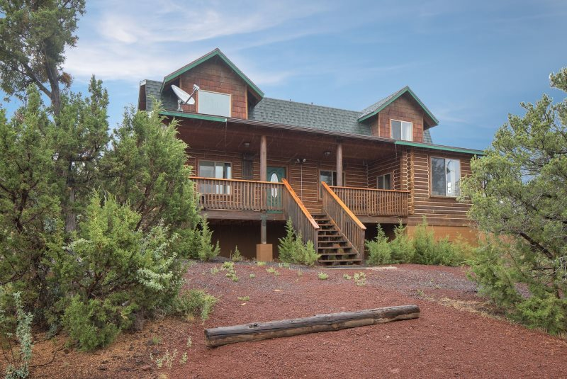 pines rental side deck in the on holiday cabins secluded cabin of rentals flagstaff parks luxury