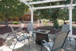 Outside Pergola with 4 chairs.