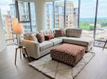 Settle into this sumptuous sectional and enjoy the views from the floor to ceiling windows.