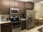 The galley style kitchen is incredibly spacious with plenty of room for meal prepping and hanging out with a coffee.