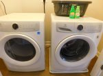 Full-size washer and dryer in the apartment.