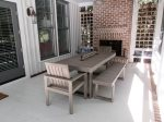 Back porch with dining table and gas fireplace
