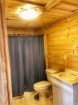 The downstairs jack & jill bathroom sits between the king bedroom and the bunk room.