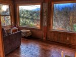 Take in the beautiful Smoky Mountain Views from the rear sun room.