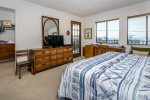 Upstairs bedroom with king size bed and ocean views