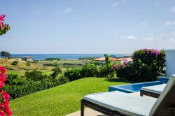 Upscale 2 bedroom Villa at Pristine Bay With Ocean & Golf Course View.