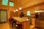 Log cabin offers open concept for gathering