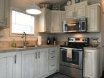 Full size oven/stove, SS Full size Refrigerator, microwave, 2 coffee makers