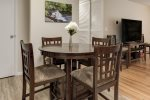 High top DiningTable has extra leaf and 6 padded chairs