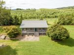 Arial drone view of Apple Hill House with Apple Trees in back.