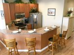 Fully Equipped Kitchen w Granite Counters and Stainless Steel Appliances - 4 Swivel Stools at the counter