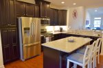 Fully Equipped Kitchen w Stainless Steel Counters and Granite Countertops, Gas Range