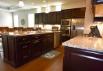 Gourmet Kitchen has stainless steel appliances and granite countertops and is fully stocked