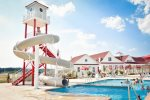 Coastal Club Features Many Pools in its water park including this huge slide