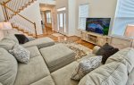You will be amazed by this 2 Story Family Room w Xtra Large HDTV
