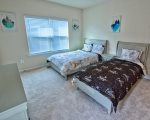 Bedroom 4 w 1 Queen Bed and 1 Twin Bed