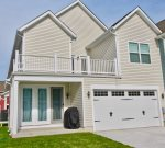 Rear View of your vacation home w 2 Car Garage and Driveway