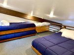 Loft with queen bed and two twin beds