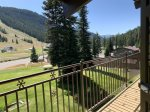 Summer view of balcony, pool, and ski area