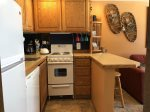 Full size fridge, compact stove in Kitchen