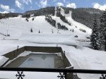 Winter view from balcony of Alpine ski area and pool