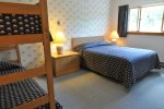 Bedroom with queen bed and set of bunks