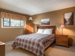Bedroom with queen size bed and set of bunks