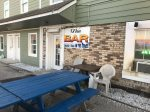 Bar located 2 doors down from unit