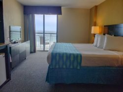 Oceanfront King Suite with Private Balcony~SunNSand 506