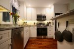 Looking into well equipped kitchen, all new appliances, counters, cabinets