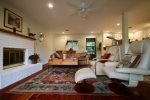 Open living room with wood burning fireplace, pre-order firewood from manager