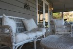 seats and swings on the screened porch