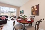 Enjoy your first meal of the day at this beautiful breakfast nook with views of the pool and backyard