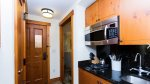 KITCHENETTE WITH MINI FRIDGE, 2 BURNER STOVE, DISHWASHER
