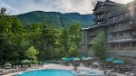 Heated outdoor pool with two hot tubs open year round and included with your stay.
