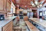 Prepare a Home Cooked Meal in This Kitchen with Top-of-the-Line Stainless Steel Appliances