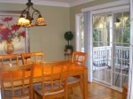 Doors lead from dining room to the lowcountry front porch