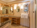 Custom cabinetry and granite countertops make this bathroom truly special