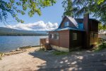 This home is situated right on the shore with easy access to the water