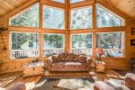Wide a-frame windows create an unforgettable cabin atmosphere.