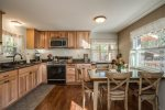 Soak your body in the hot tub and your soul in the surrounding nature.